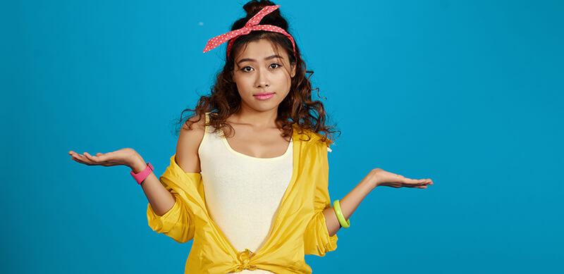 Quem tem ProUni pode fazer Sisu: fotografia de uma menina fazendo sinal de dúvida.